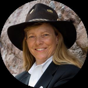 Hunter Lovins smiling and wearing a black cowboy hat
